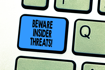 Text sign showing Beware Insider Threats. Conceptual photo Be cautious on malicious attack inside the network Keyboard key Intention to create computer message pressing keypad idea