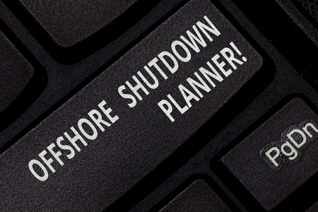 Text sign showing Offshore Shutdown Planner. Conceptual photo Responsible for plant maintenance shutdown Keyboard key Intention to create computer message pressing keypad idea