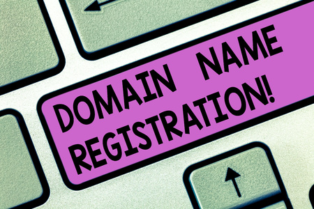 Handwriting text Domain Name Registration. Concept meaning process of reserving a name on the Internet Keyboard key Intention to create computer message pressing keypad idea