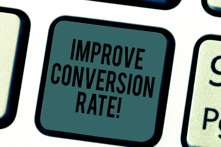 Handwriting text writing Improve Conversion Rate. Concept meaning Increase the percentage of visitors to your website Keyboard key Intention to create computer message pressing keypad idea Stock Photo