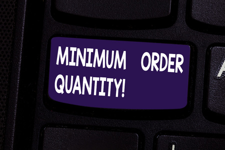 Handwriting text Minimum Order Quantity. Concept meaning lowest quantity of a product a supplier can sell Keyboard key Intention to create computer message pressing keypad idea