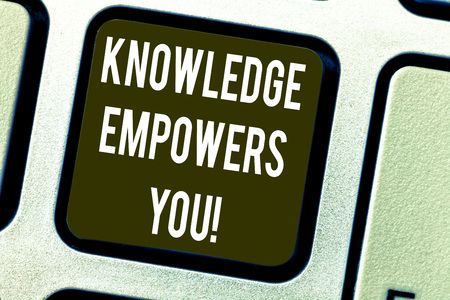 Conceptual hand writing showing Knowledge Empowers You. Business photo text To equip someone with skills and knowledge to do task Keyboard key Intention to create computer message idea Archivio Fotografico