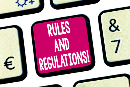 Text sign showing Rules And Regulations. Conceptual photo guidelines to follow when entering into a transaction Keyboard key Intention to create computer message pressing keypad idea