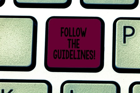 Writing note showing Follow The Guidelines. Business photo showcasing Pay attention to general rule, principles or advice Keyboard key Intention to create computer message pressing keypad idea