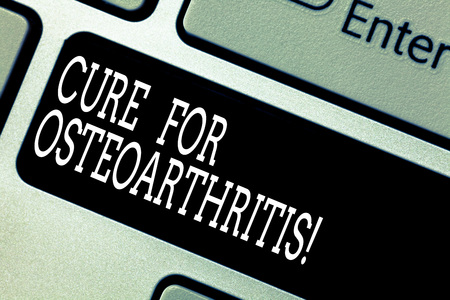 Text sign showing Cure For Osteoarthritis. Conceptual photo Treatment for the pain and stiffness of joints Keyboard key Intention to create computer message pressing keypad idea Stock Photo