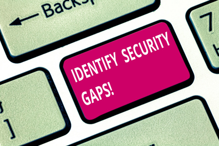 Writing note showing Identify Security Gaps. Business photo showcasing determine whether the controls in place are enough Keyboard key Intention to create computer message pressing keypad idea