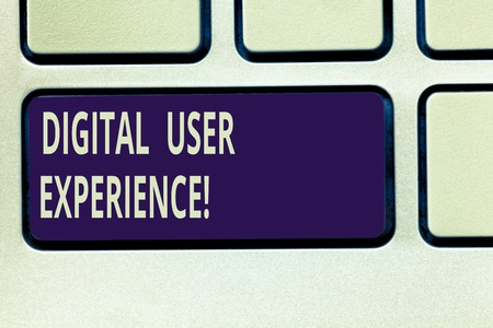 Text sign showing Digital User Experience. Conceptual photo demonstrating s is emotions about using a particular product Keyboard key Intention to create computer message pressing keypad idea 写真素材