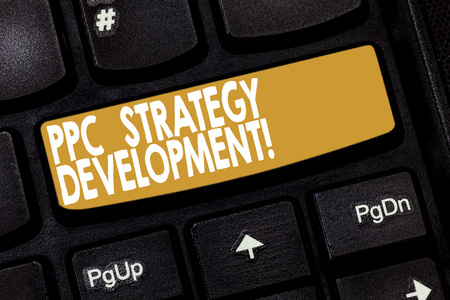 Word writing text Ppc Strategy Development. Business concept for To develop a plan of action to build effective PPC Keyboard key Intention to create computer message pressing keypad idea Imagens