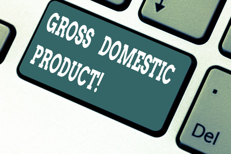 Writing note showing Gross Domestic Product. Business photo showcasing total value of everything produced in the country Keyboard key Intention to create computer message pressing keypad idea