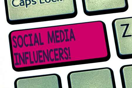 Conceptual hand writing showing Social Media Influencers. Business photo text showing who have a reputation for their knowledge Keyboard key Intention to create computer message idea