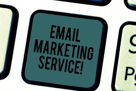 Handwriting text writing Email Marketing Service. Concept meaning email sent to a potential or current customer Keyboard key Intention to create computer message pressing keypad idea Stock fotó