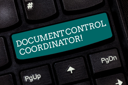 Writing note showing Document Control Coordinator. Business photo showcasing analysisaging and controlling company documents Keyboard key Intention to create computer message pressing keypad idea