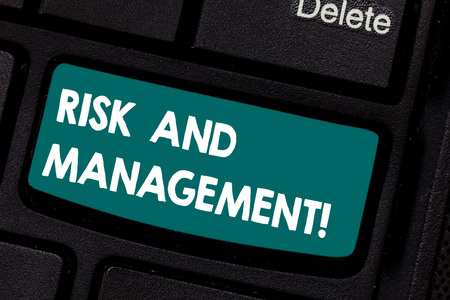 Conceptual hand writing showing Risk And Management. Business photo showcasing forecasting evaluation financial risks minimize impact Keyboard key Intention to create computer message idea Stock Photo