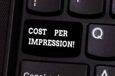 Text sign showing Cost Per Impression. Conceptual photo refers rate that advertiser has agreed to pay for number Keyboard key Intention to create computer message pressing keypad idea Stock fotó