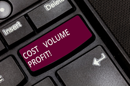 Writing note showing Cost Volume Profit. Business photo showcasing form of cost accounting and It is simplified model Keyboard key Intention to create computer message pressing keypad idea
