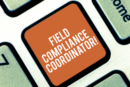 Conceptual hand writing showing Field Compliance Coordinator. Business photo text assist in preparation of regulatory documents Keyboard key Intention to create computer message idea Stock Photo