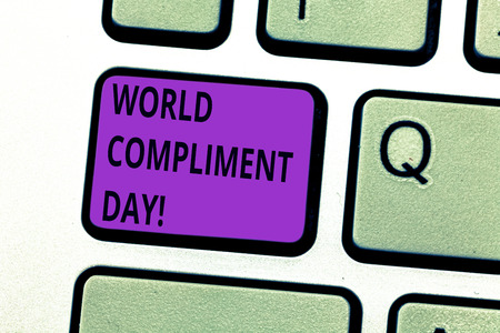 Writing note showing World Compliment Day. Business photo showcasing basic huanalysis need for recognition and appreciation day Keyboard key Intention to create computer message pressing keypad idea