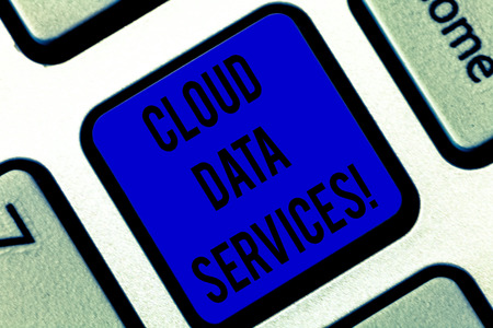 Writing note showing Cloud Data Services. Business photo showcasing enables data access on deanalysisd users regardless location Keyboard key Intention to create computer message pressing keypad idea Stock Photo