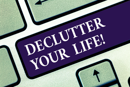 Text sign showing Declutter Your Life. Conceptual photo remove unnecessary items from untidy overcrowded place Keyboard key Intention to create computer message pressing keypad idea Stock Photo