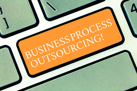Writing note showing Business Process Outsourcing. Business photo showcasing Contracting work to external service provider Keyboard key Intention to create computer message pressing keypad idea Banque d'images