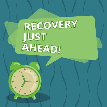 Writing note showing Recovery Just Ahead. Business photo showcasing return to normal state of health mind or strength soon Blank Rectangular Color Speech Bubble Overlay and Analog Alarm Clock Imagens