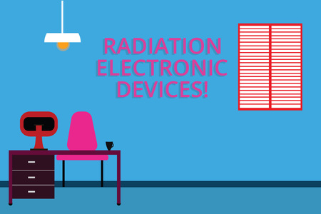 Handwriting text Radiation Electronic Devices. Concept meaning radio frequency emitted by electronic devices Work Space Minimalist Interior Computer and Study Area Inside a Room photo