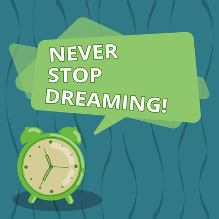 Writing note showing Never Stop Dreaming. Business photo showcasing dont waste your time in fantasy stick to achieve them Blank Rectangular Color Speech Bubble Overlay and Analog Alarm Clock
