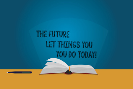 Handwriting text The Future Depends On What You Do Today. Concept meaning Make things now to obtain success Color Pages of Open Book photo on Table with Pen and Light Beam Glaring