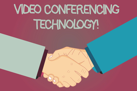 Conceptual hand writing showing Video Conferencing Technology. Business photo text People globally interacted through video data Hu analysis Shaking Hands on Agreement Sign of Respect and Honor 写真素材