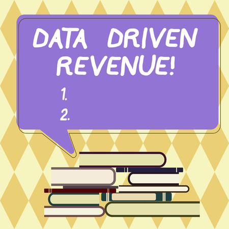 Text sign showing Data Driven Revenue. Conceptual photo makes strategic decisions based analysis interpretation Uneven Pile of Hardbound Books and Blank Rectangular Color Speech Bubble Stock Photo