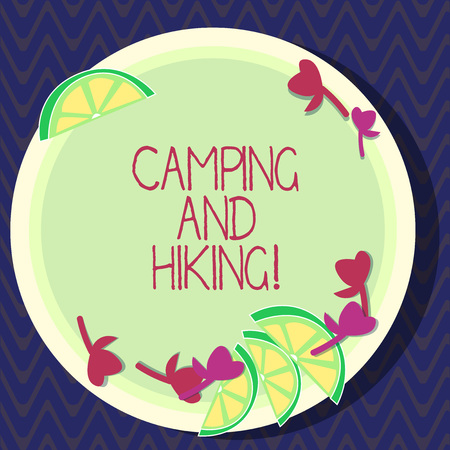 Text sign showing Camping And Hiking. Conceptual photo outdoor activity involving staying away from home Cutouts of Sliced Lime Wedge and Herb Leaves on Blank Round Color Plate