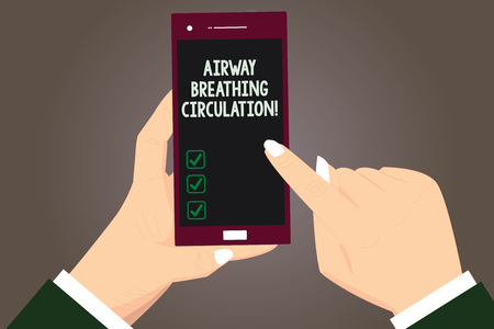 Word writing text Airway Breathing Circulation. Business concept for Memory aid for rescuers performing CPR Hu analysis Hands Holding Pointing Touching Smartphone Blank Color Screen Foto de archivo