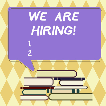 Text sign showing We Are Hiring. Conceptual photo pay someone to do a particular job for company in future Uneven Pile of Hardbound Books and Blank Rectangular Color Speech Bubble Banco de Imagens