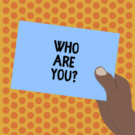 Writing note showing Who Are Youquestion. Business photo showcasing refer to demonstrating showing being spoken or written to Drawn Hu analysis Hand Holding Blank Color Paper Cardboard Reklamní fotografie