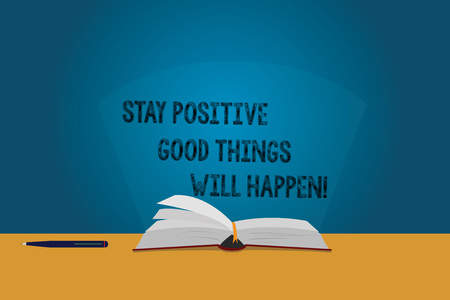Handwriting text Stay Positive Good Things Will Happen. Concept meaning Keep your motivation inspiration Color Pages of Open Book photo on Table with Pen and Light Beam Glaring 版權商用圖片