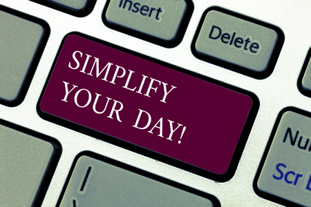 Text sign showing Simplify Your Day. Conceptual photo make simple or reduce things to basic essentials Keyboard key Intention to create computer message pressing keypad idea Foto de archivo