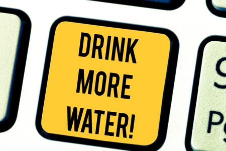 Text sign showing Drink More Water. Conceptual photo increase amount of drinking water required varies everyday Keyboard key Intention to create computer message pressing keypad idea