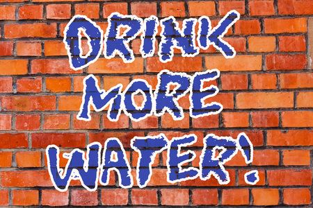Word writing text Drink More Water. Business concept for increase amount of drinking water required varies everyday Brick Wall art like Graffiti motivational call written on the wall Banco de Imagens
