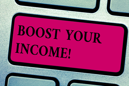 Writing note showing Boost Your Income. Business photo showcasing increase month or annual salary using part time job Keyboard key Intention to create computer message pressing keypad idea