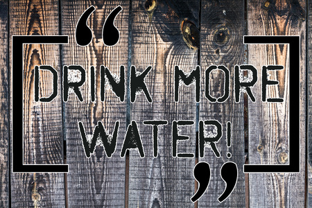 Handwriting text Drink More Water. Concept meaning increase amount of drinking water required varies everyday Wooden background vintage wood wild message ideas intentions thoughts