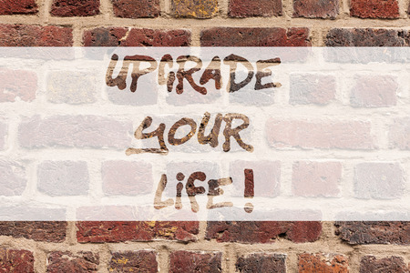 Writing note showing Upgrade Your Life. Business photo showcasing improve your way of living Getting wealthier and happier Brick Wall art like Graffiti motivational call written on the wall Stockfoto