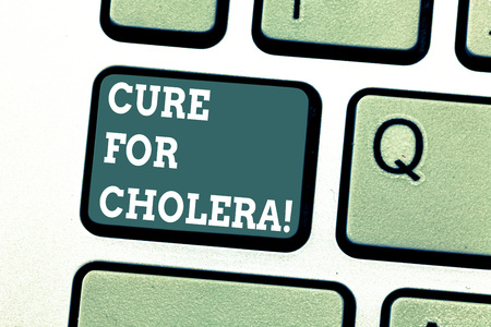 Writing note showing Cure For Cholera. Business photo showcasing restoration of lost fluids and salts through rehydration Keyboard key Intention to create computer message pressing keypad idea
