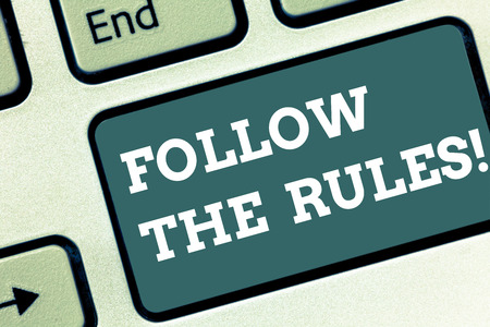 Writing note showing Follow The Rules. Business photo showcasing act in agreement or compliance with obey them Firmly Keyboard key Intention to create computer message pressing keypad idea