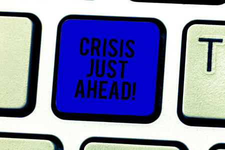 Word writing text Crisis Just Ahead. Business concept for time of intense difficulty or danger coming soon Keyboard key Intention to create computer message pressing keypad idea