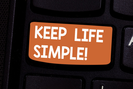 Conceptual hand writing showing Keep Life Simple. Business photo showcasing invitation anyone not complexing things or matters Keyboard key Intention to create computer message idea 写真素材