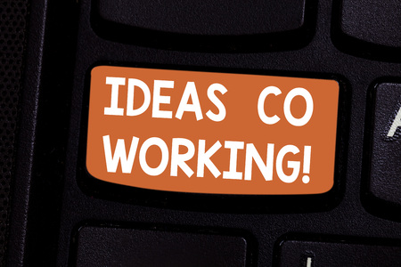 Conceptual hand writing showing Ideas Co Working. Business photo showcasing use of working environment by showing who are self employed Keyboard key Intention to create computer message idea
