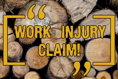 Handwriting text writing Work Injury Claim. Concept meaning insurance providing medical benefits to employees Wooden background vintage wood wild message ideas intentions thoughts
