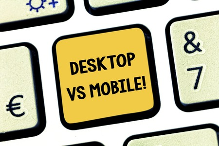 Conceptual hand writing showing Desktop Vs Mobile. Business photo showcasing comparing demonstratingal computer versus laptop or cell phones Keyboard key Intention to create computer message idea Stock Photo