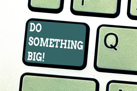 Writing note showing Do Something Big. Business photo showcasing achieving a such position which is beyond expectations Keyboard key Intention to create computer message pressing keypad idea 写真素材
