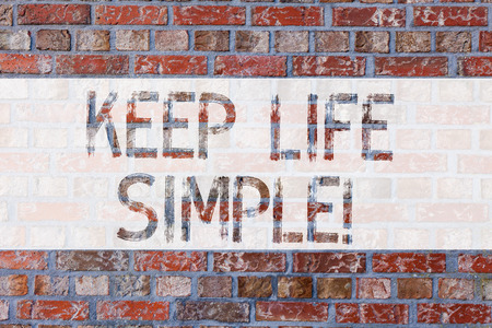 Handwriting text writing Keep Life Simple. Concept meaning invitation anyone not complexing things or matters Brick Wall art like Graffiti motivational call written on the wall